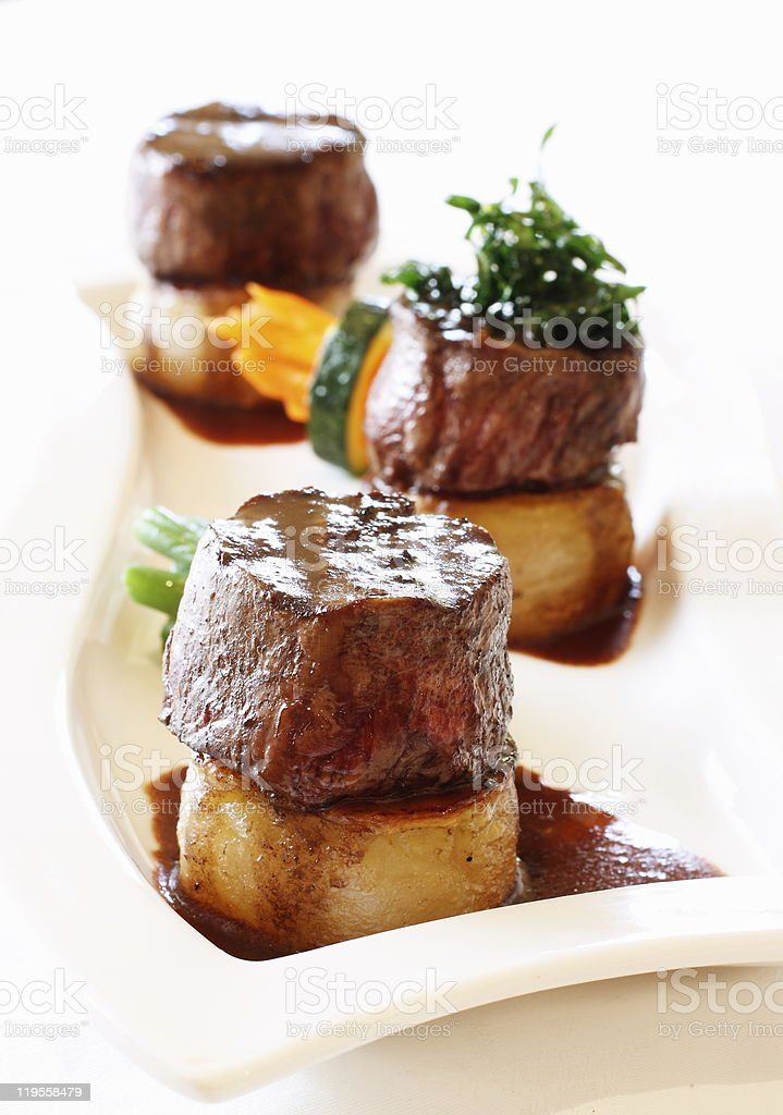 Beef Medallions on White Plate with Vegetables stock photo