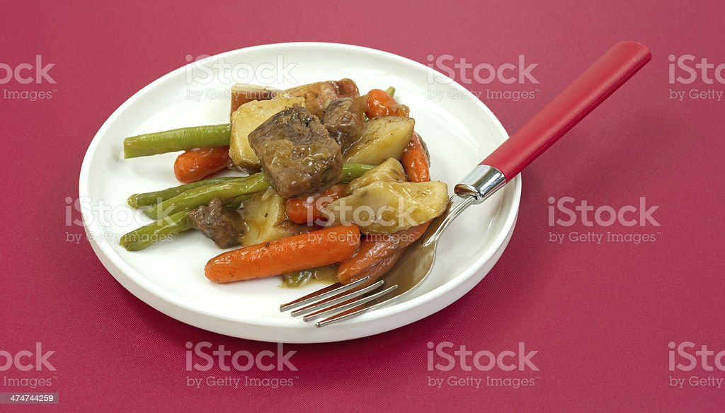 Beef Merlot TV dinner on plate with fork royalty-free stock photo