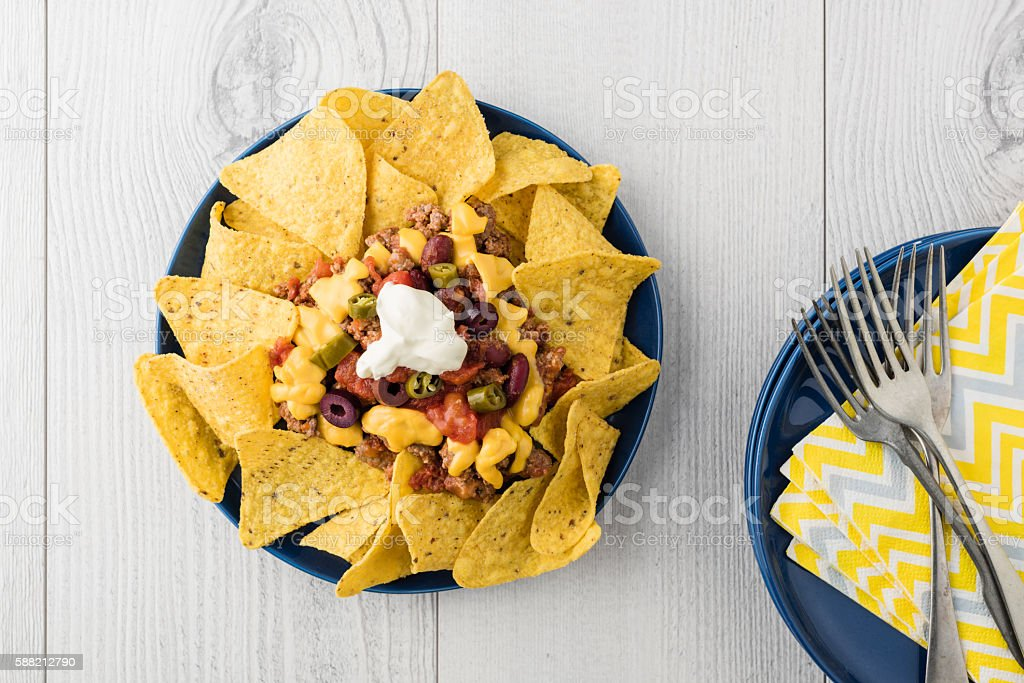 Beef nachos with  jalapeno, olives, tomato, beans cheddar cheese stock photo