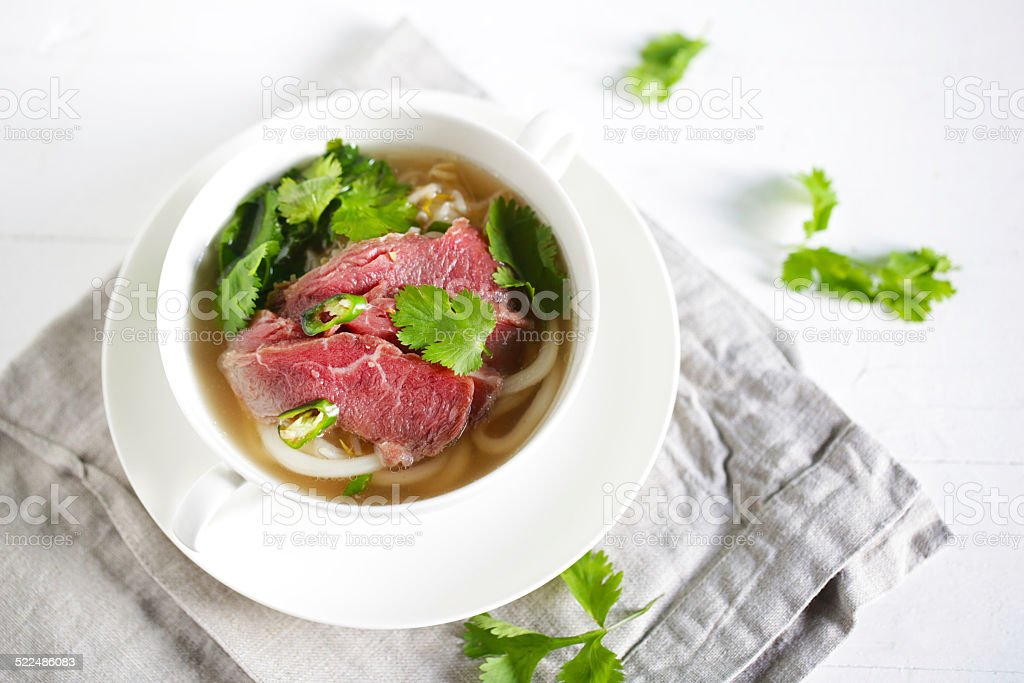 Beef noodle soup with noodles, pho from vietnam with coriander stock photo