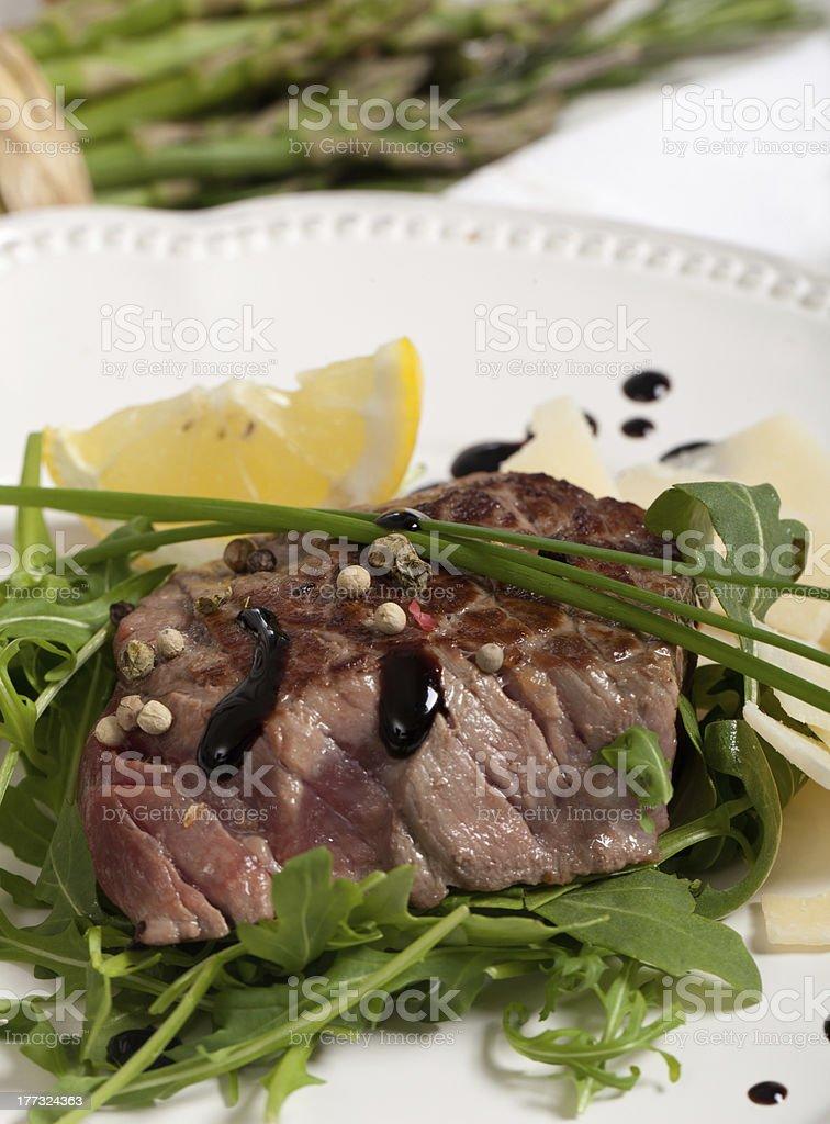 Beef on arugula salad and parmesan royalty-free stock photo