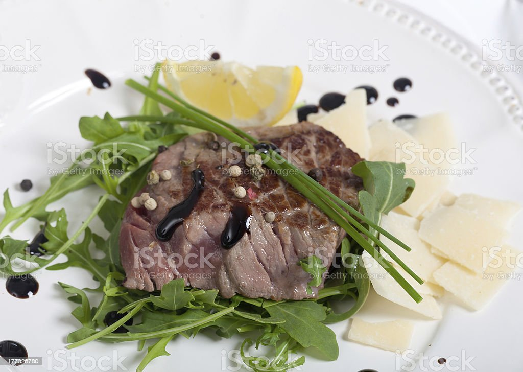 Beef on arugula salad and parmesan royalty-free stock photo