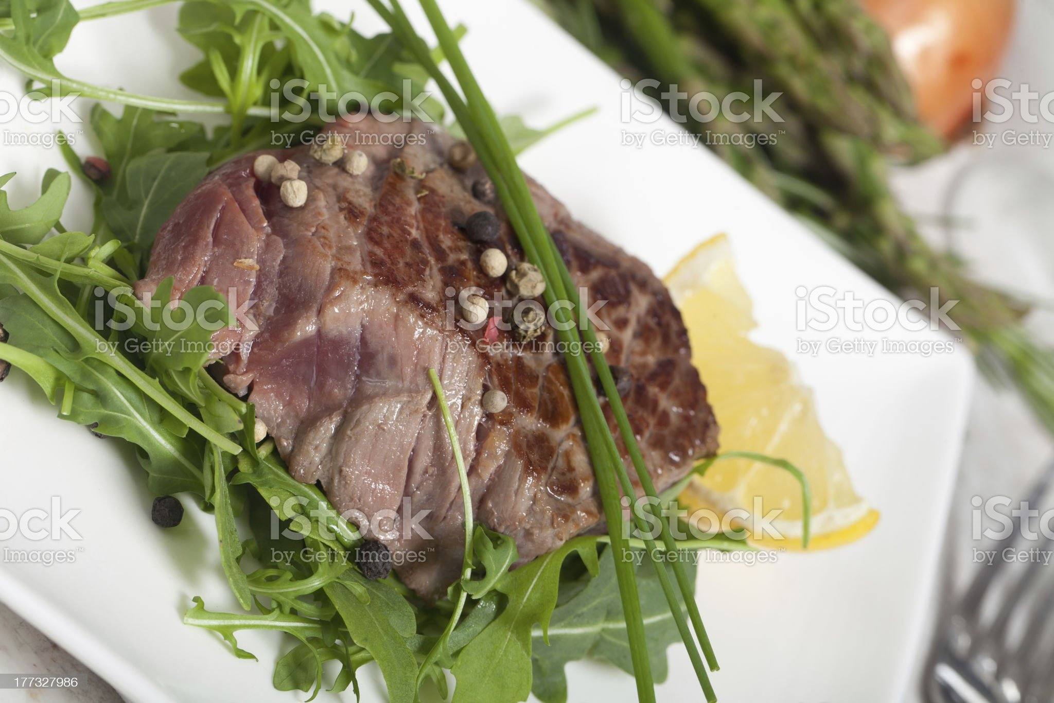 Beef on arugula salad royalty-free stock photo