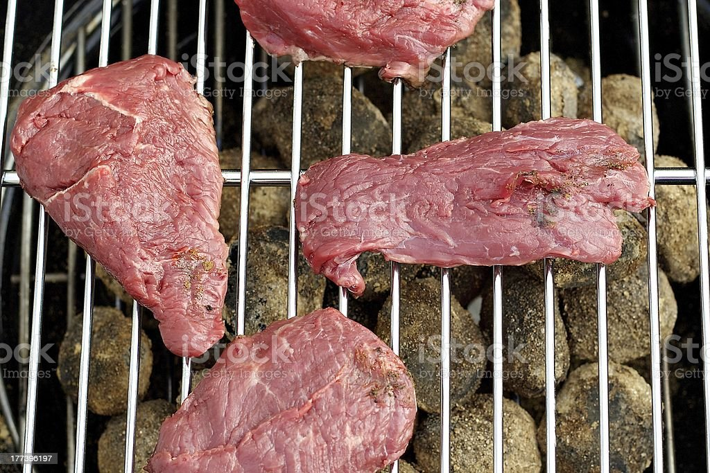 beef on charcoal barbecue close-up stock photo