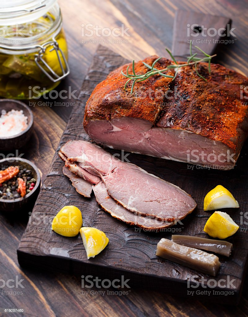 Beef pastrami sliced, roasted beef, slow cooking, marinated olive oils stock photo