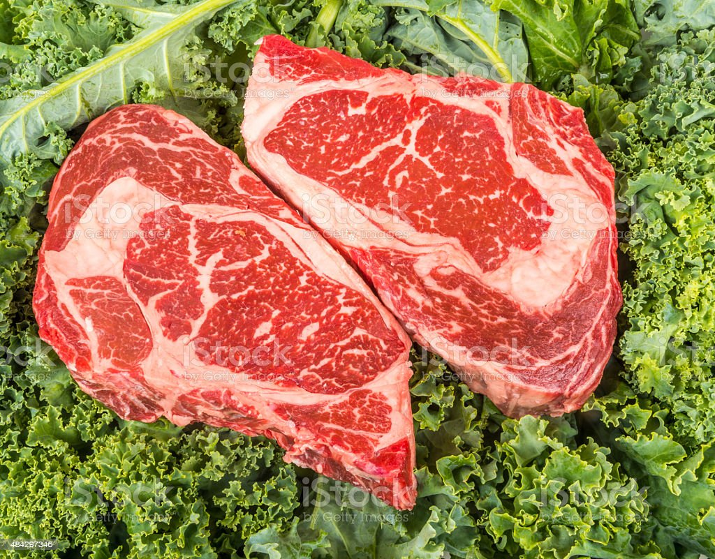 Beef rib eye on the salad leafs stock photo