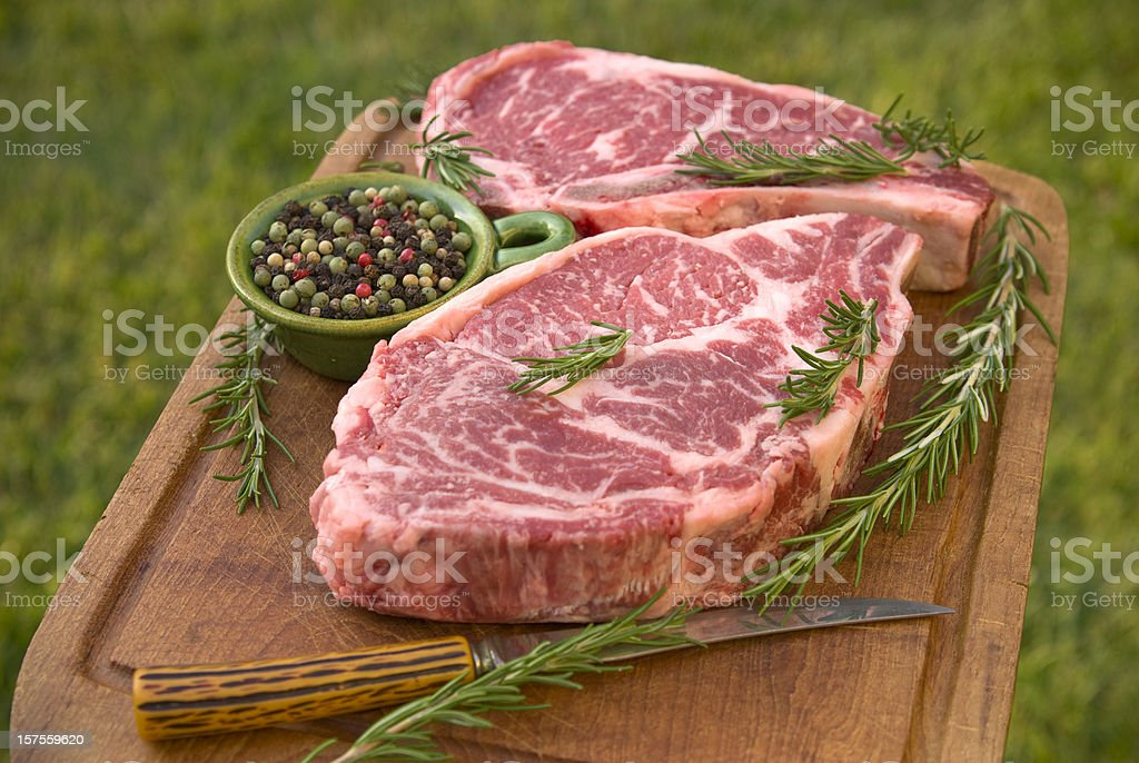 Beef Rib Eye Raw Meat Steak Cooking Dinner: Rosemary & Pepper stock photo