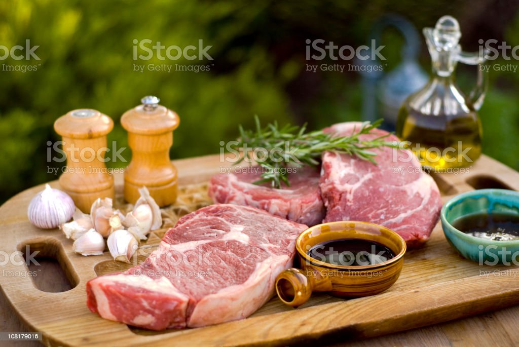 Beef Rib Eye Steaks, Fresh Raw Meat Marinade & Barbeque Cooking stock photo