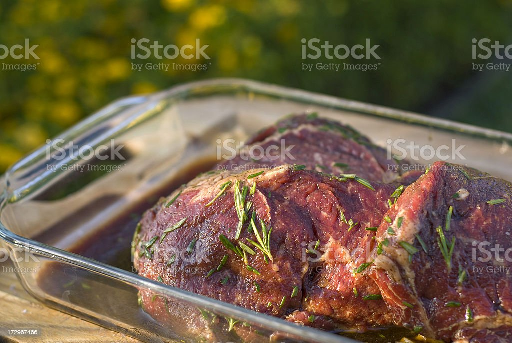 Beef Rib Eye Steaks, Raw Meat & Rosemary Marinade & Barbeque Cooking stock photo