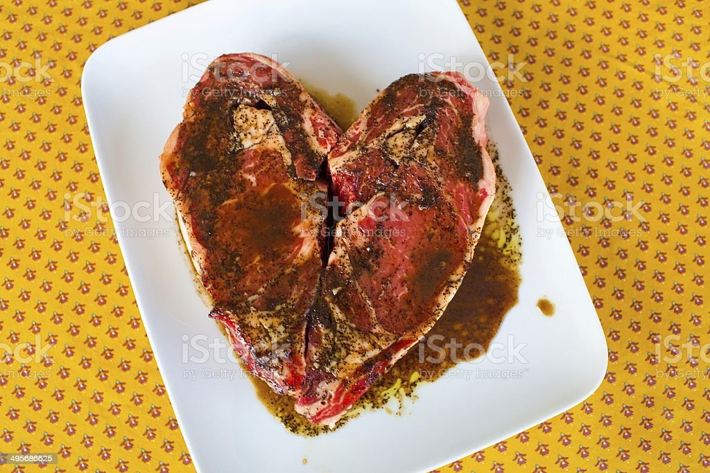 Beef Ribeye steak in the shape of a heart royalty-free stock photo