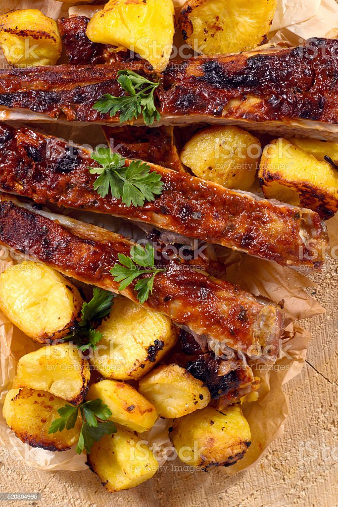 Beef ribs and baked potatoes from above stock photo