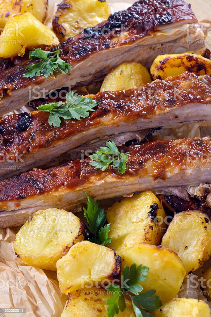 Beef ribs and baked potatoes stock photo
