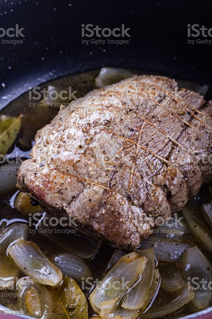 Beef roast just taken from the oven. stock photo