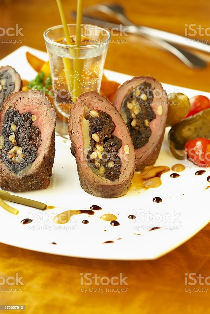 Beef rolls with prunes, cheese and nuts royalty-free stock photo