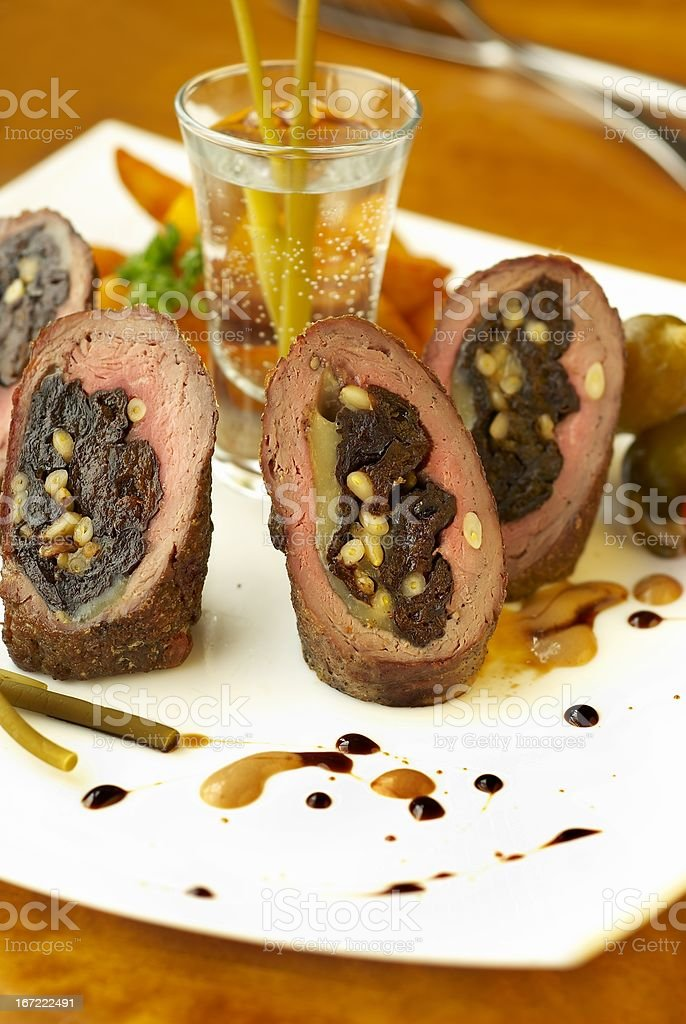 Beef rolls with prunes, cheese and pine nuts royalty-free stock photo