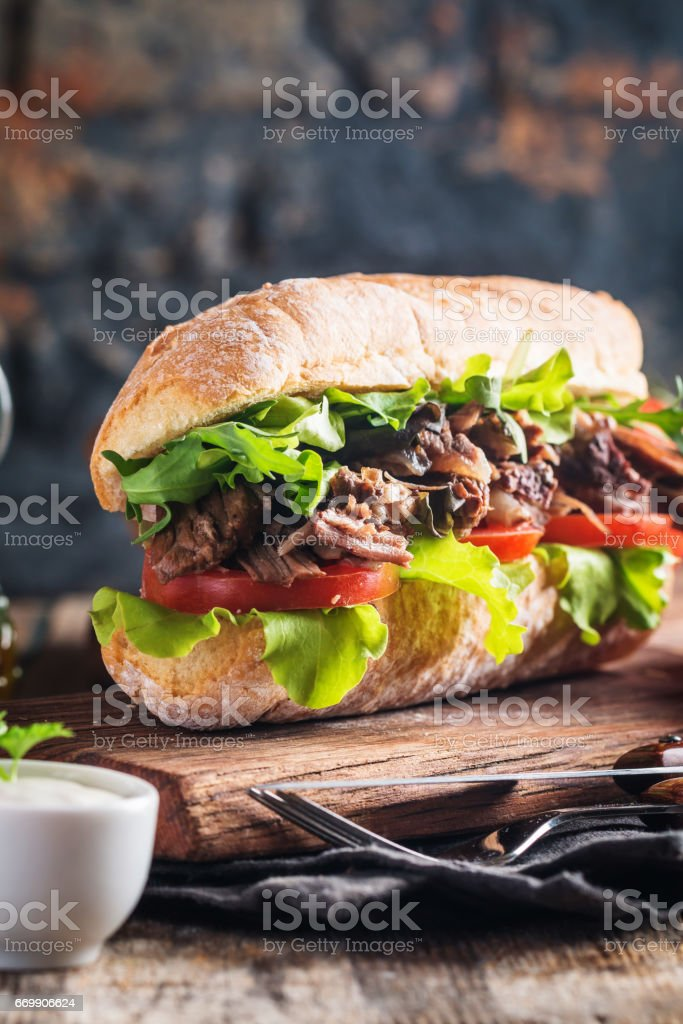 Beef sandwich with tomato and salad stock photo