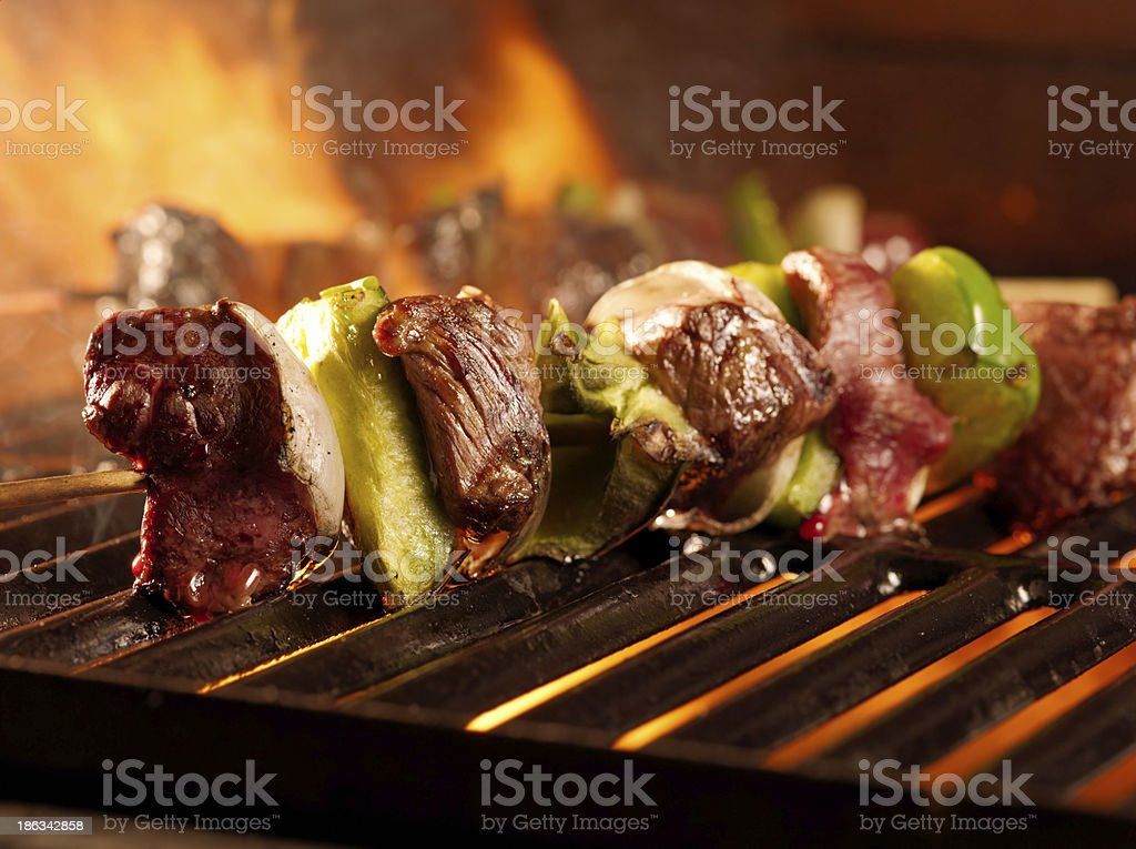 beef shishkababs on the grill close up stock photo