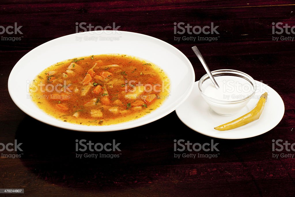 Beef soup served whit chilly and sour cream royalty-free stock photo