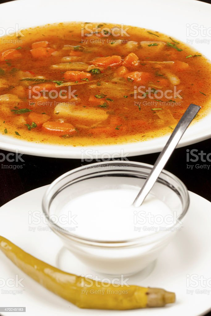 Beef soup served whit chilly and sour cream stock photo