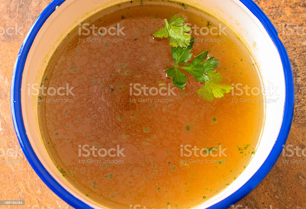 Beef soup with parsley close up stock photo