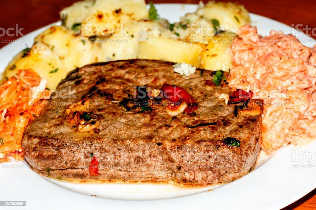 Beef steak and potatoes stock photo