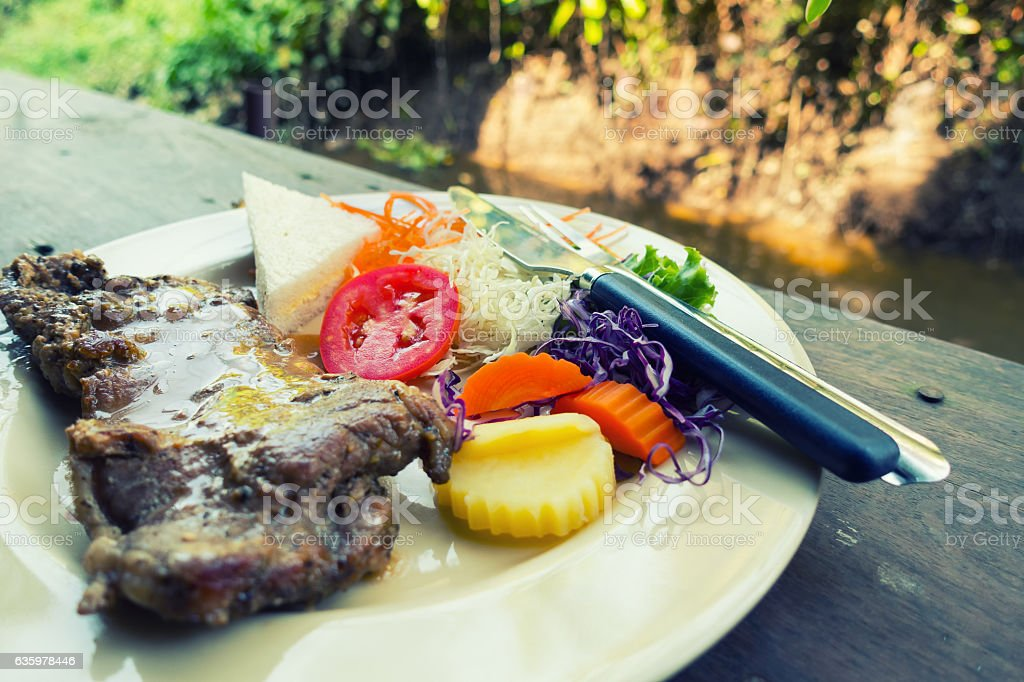 Beef steak and salad on table. stock photo