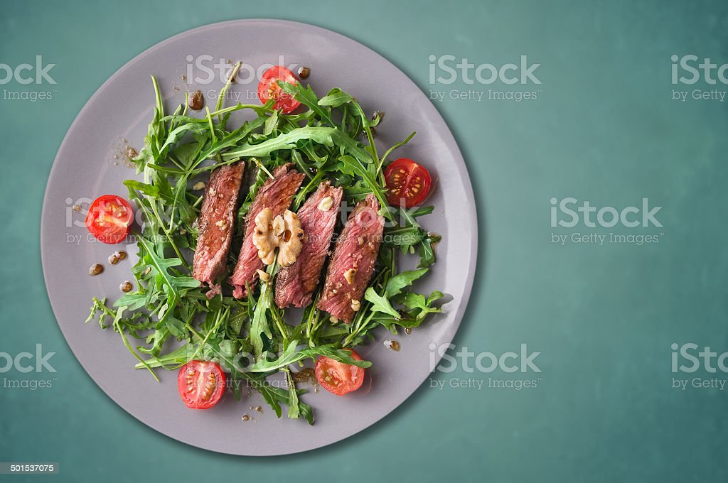 beef steak medium, Ruccola with tomatoes and walnuts stock photo