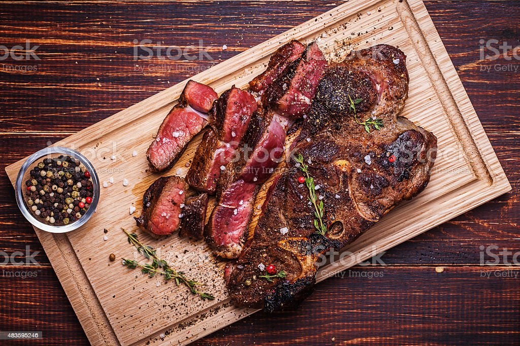 Beef steak on  a wooden background stock photo