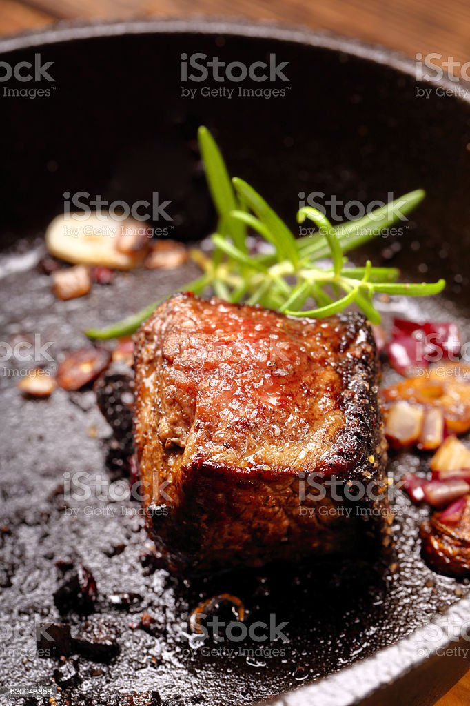 Beef steak on cast iron skillet stock photo