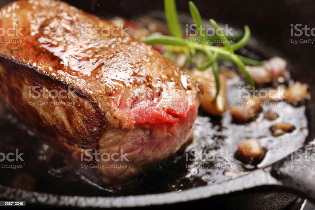 Beef steak on cast iron skillet stock photo