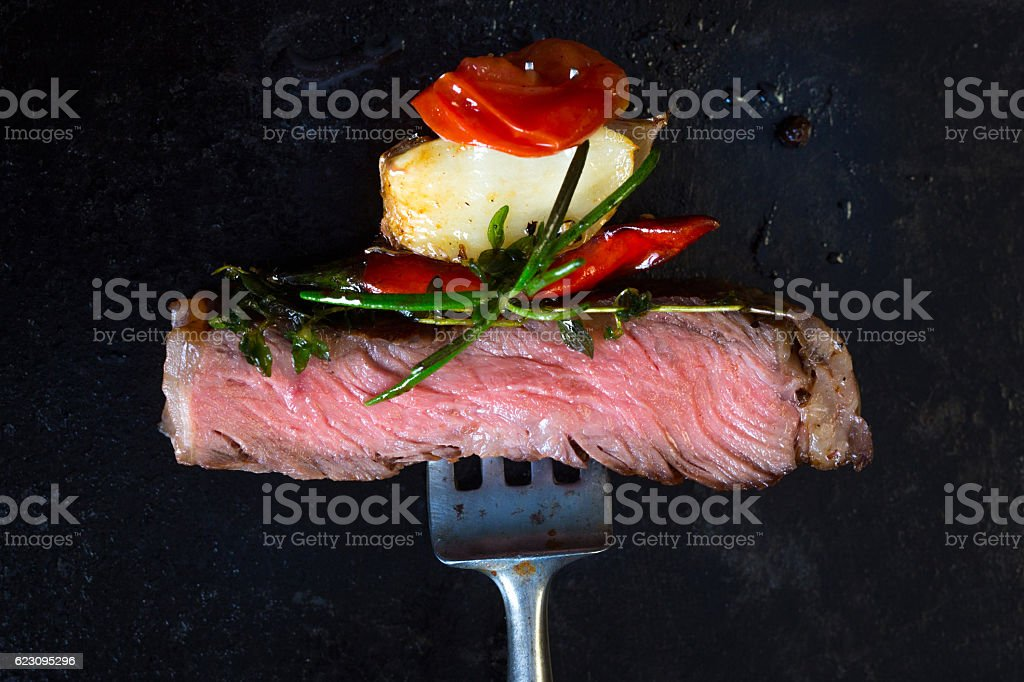 Beef steak on fork stock photo
