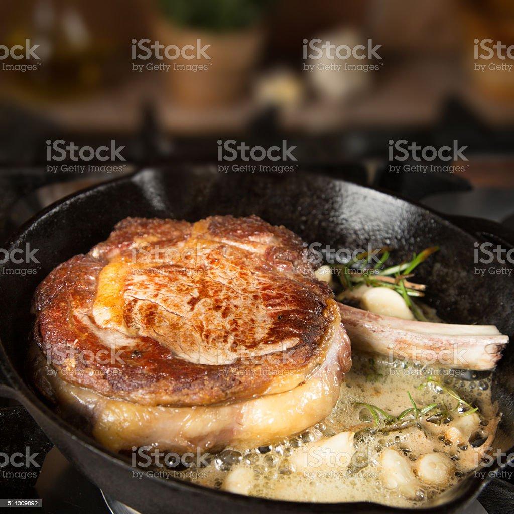 Beef steak on iron pan stock photo