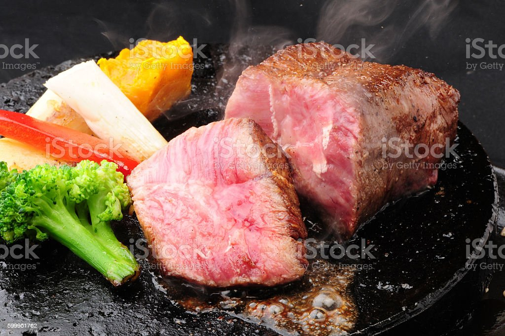 Beef steak on iron plate stock photo