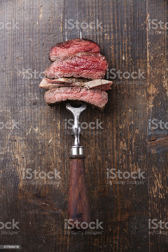 beef steak on meat fork stock photo