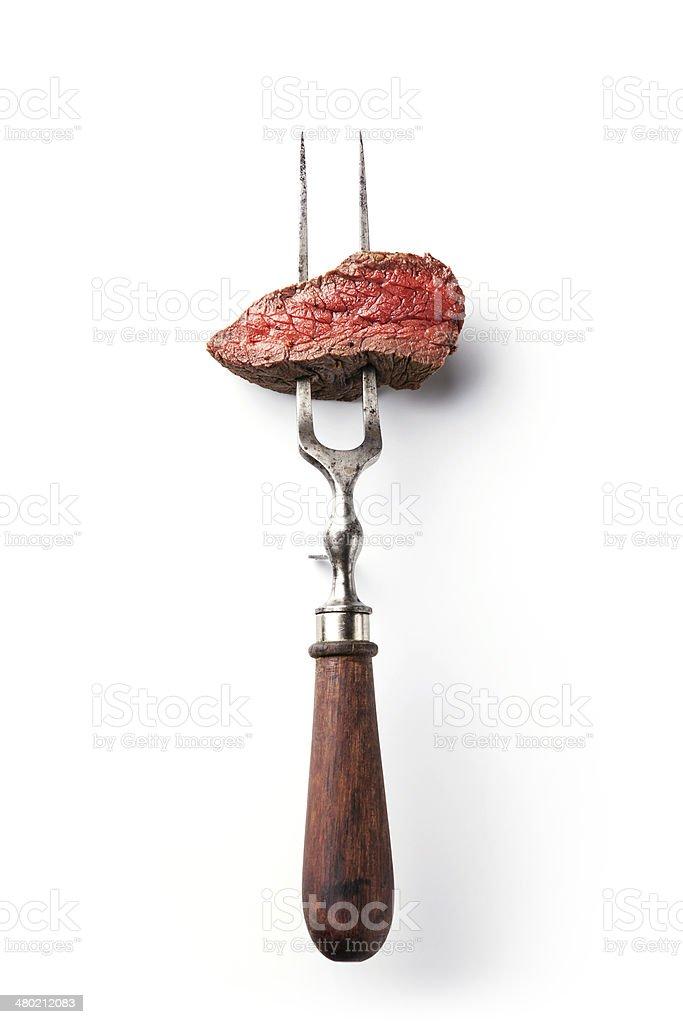 beef steak on meat fork stock photo