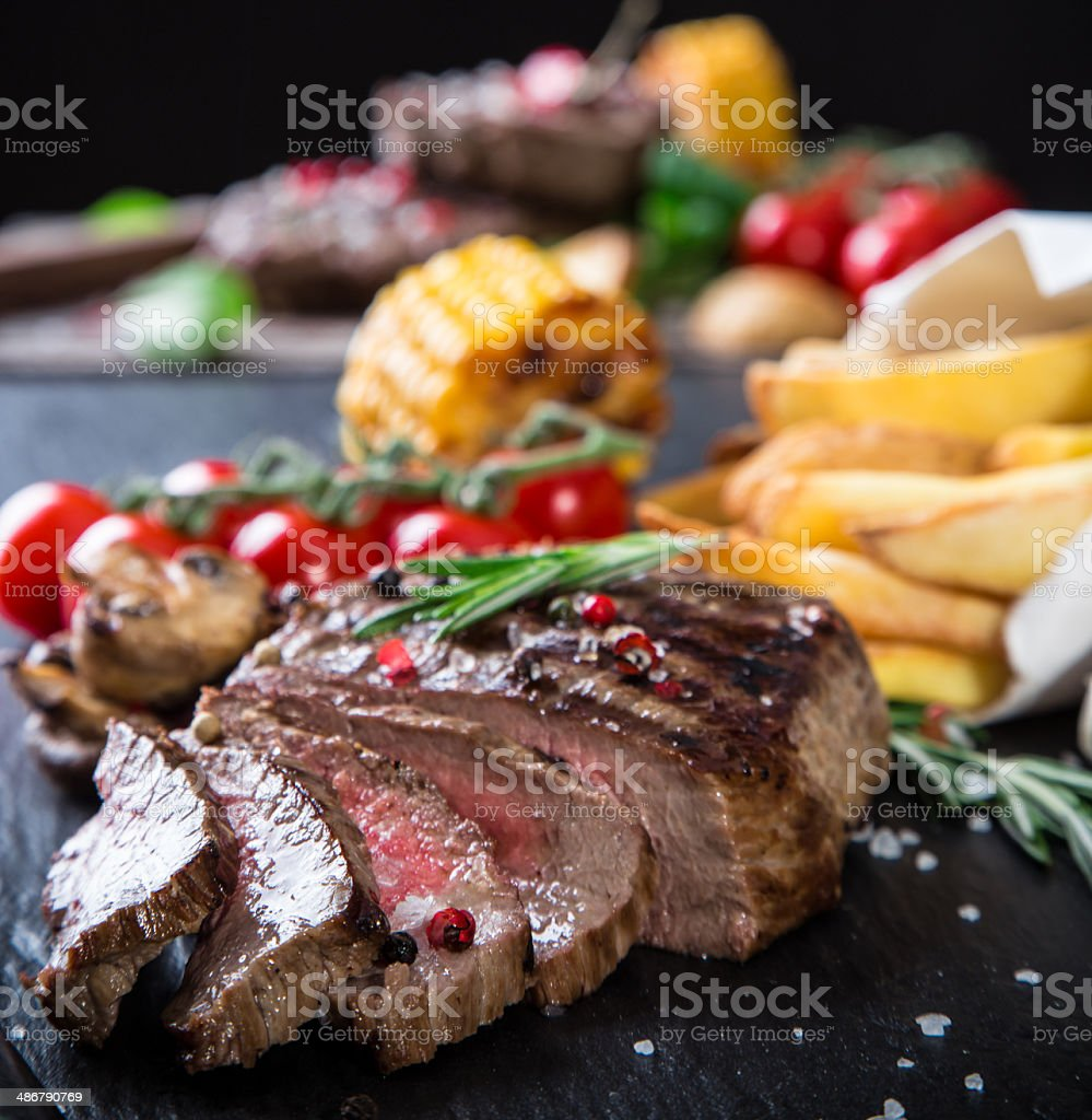 Beef steak on wooden table royalty-free stock photo
