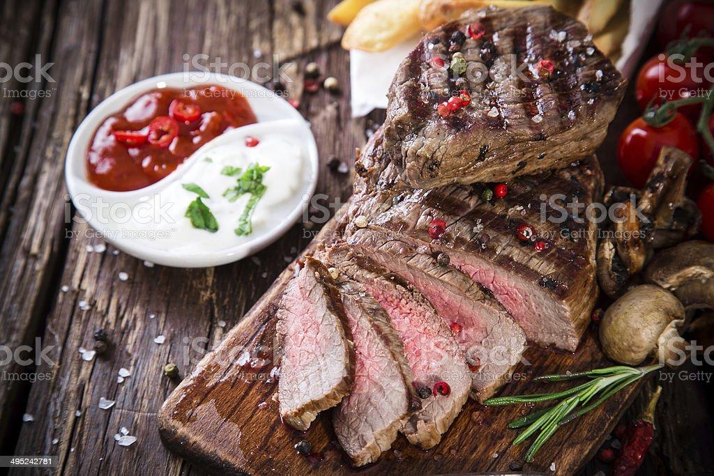 Beef steak on wooden table stock photo