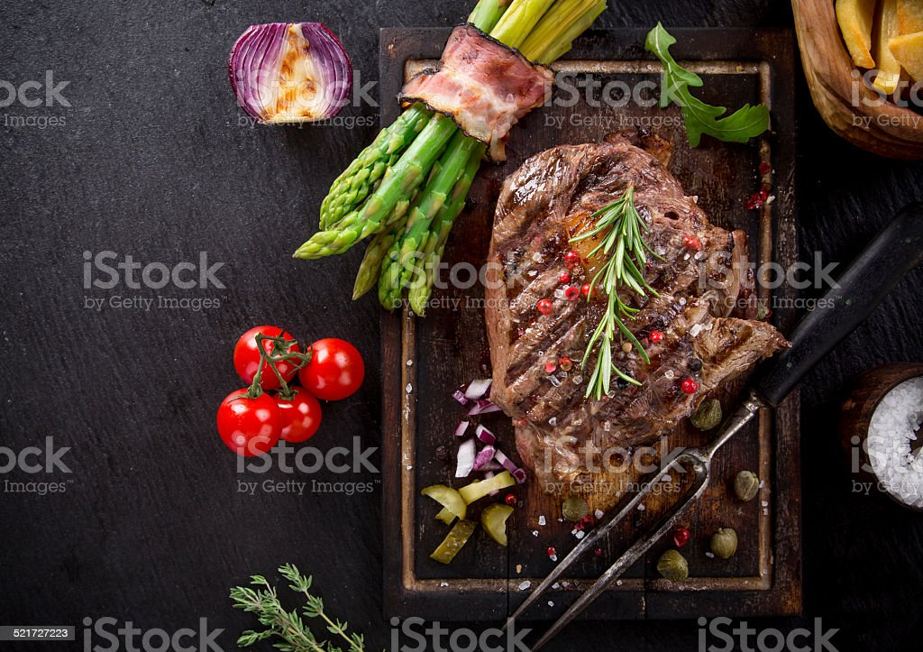 Beef steak on wooden table stock photo
