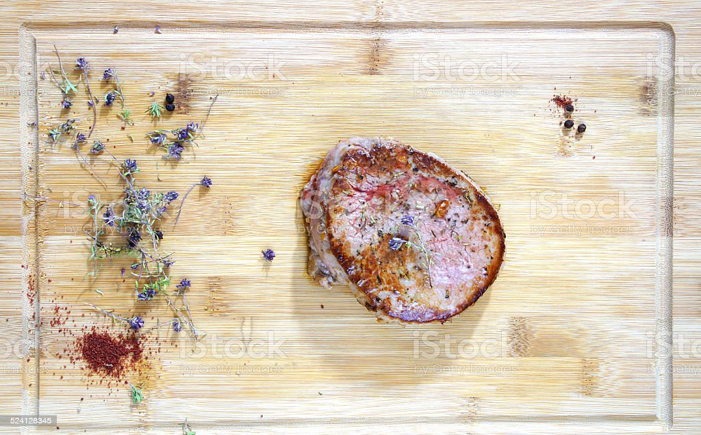 beef steak rare on the wooden cutting board stock photo
