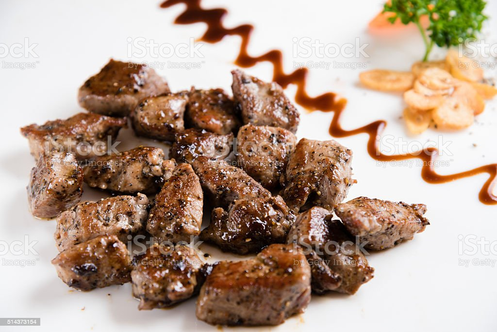 Beef Steak Served on a Sizzling Iron Plate stock photo
