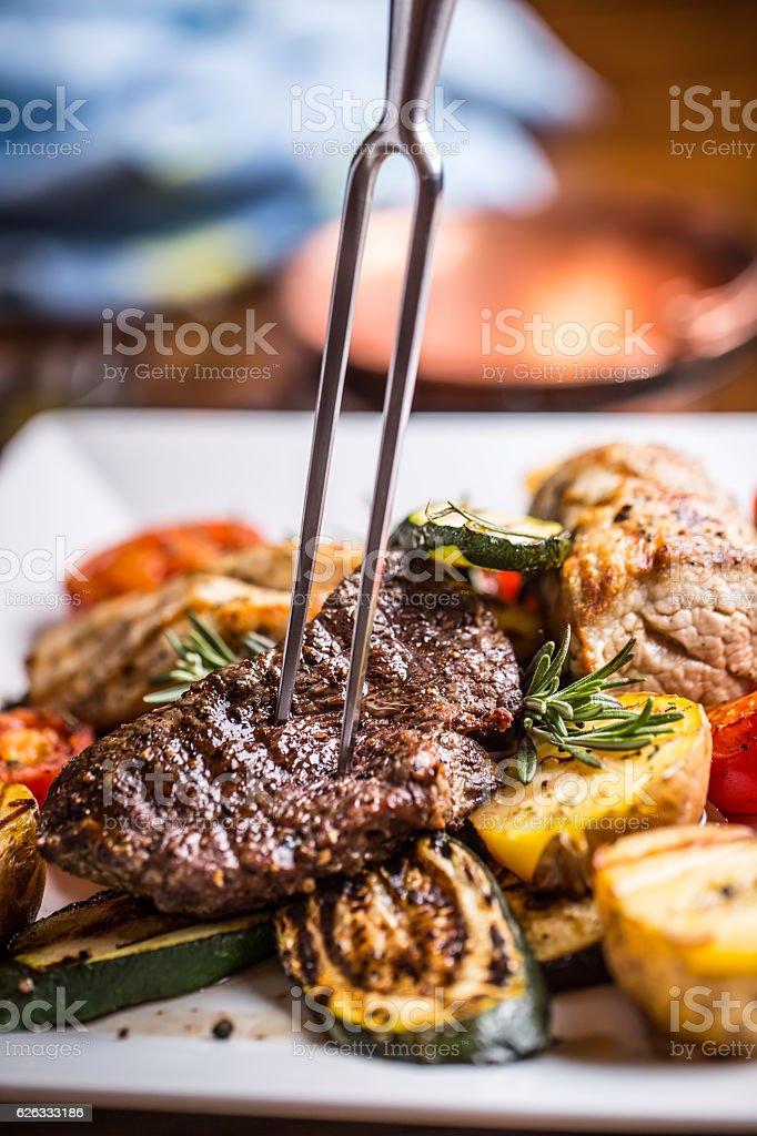 Beef Steak. Sirloin steak. Delicious juicy beef steak on fork. stock photo