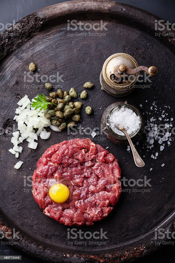 Beef Steak Tartare with capers and onions stock photo