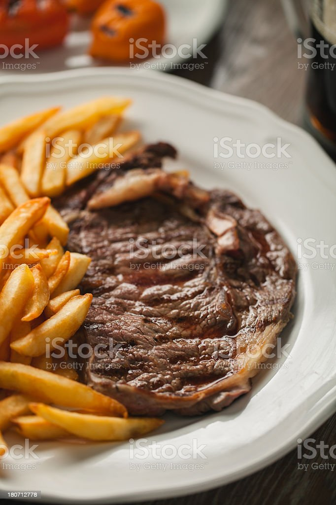 Beef steak with French fries royalty-free stock photo