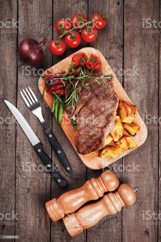 Beef steak with potato and vegetables stock photo