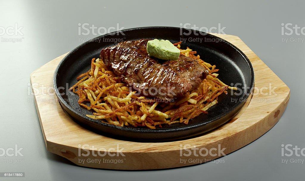 Beef steak with potatoes stock photo