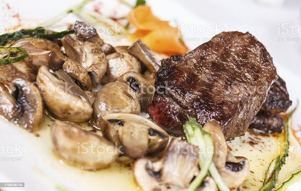 Beef steak with tasty mushrooms and truffle oil royalty-free stock photo
