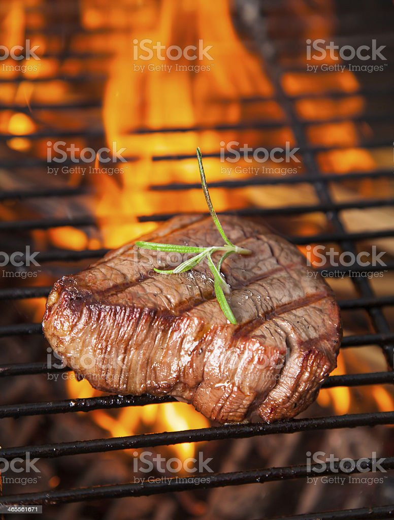 Beef steaks being cooked on a grill stock photo
