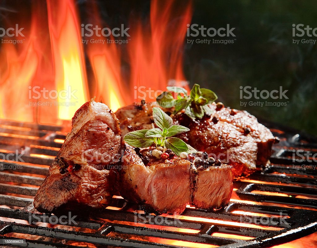 Beef steaks in the flames stock photo