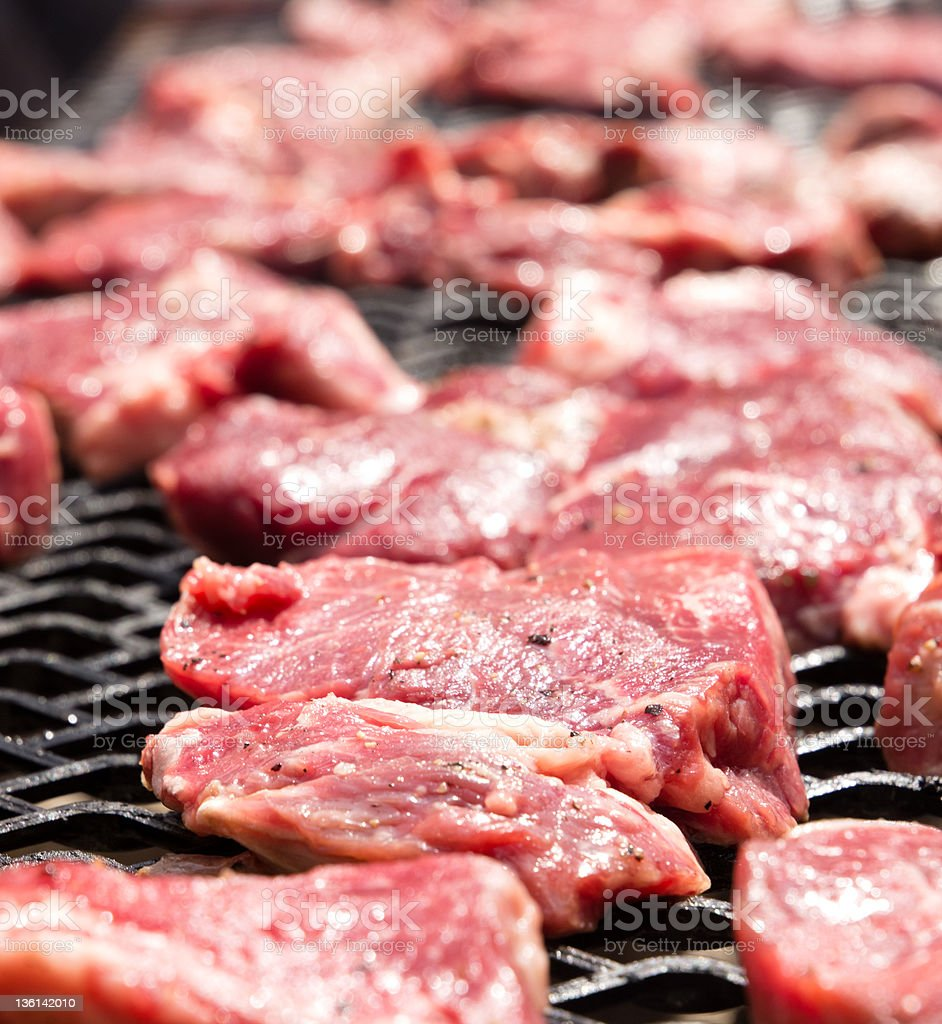 Beef Steaks on a home made barbecue royalty-free stock photo