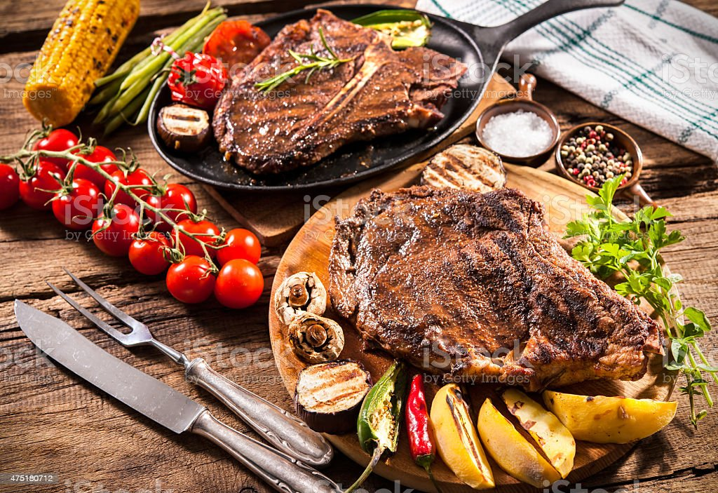 Beef steaks with grilled vegetables stock photo
